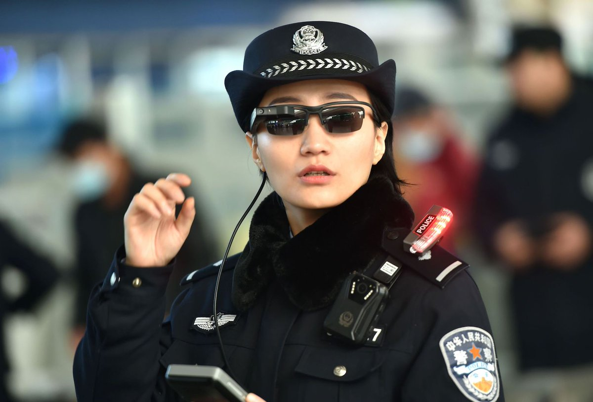 Picture of a Chinese police officer with face recognition enabled smart glasses. Image: AFP/Getty Images