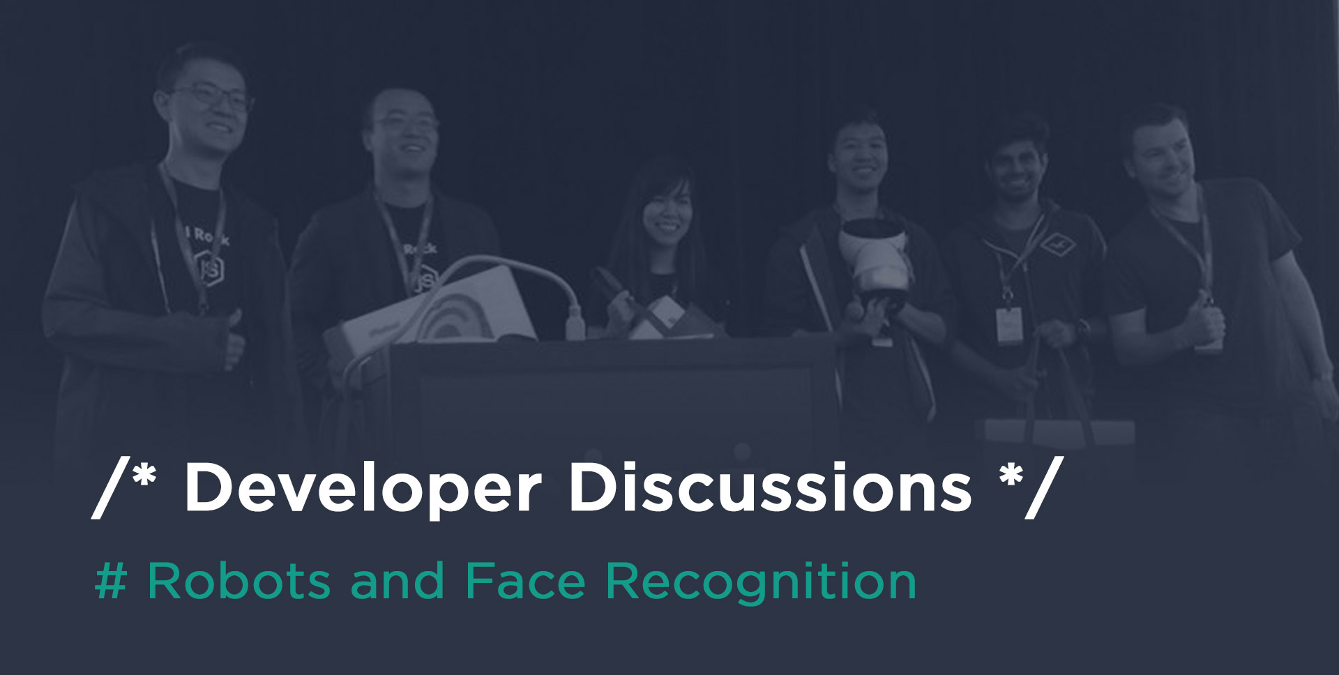Photo of a team of developers on stage at a hackathon about robots and face recognition