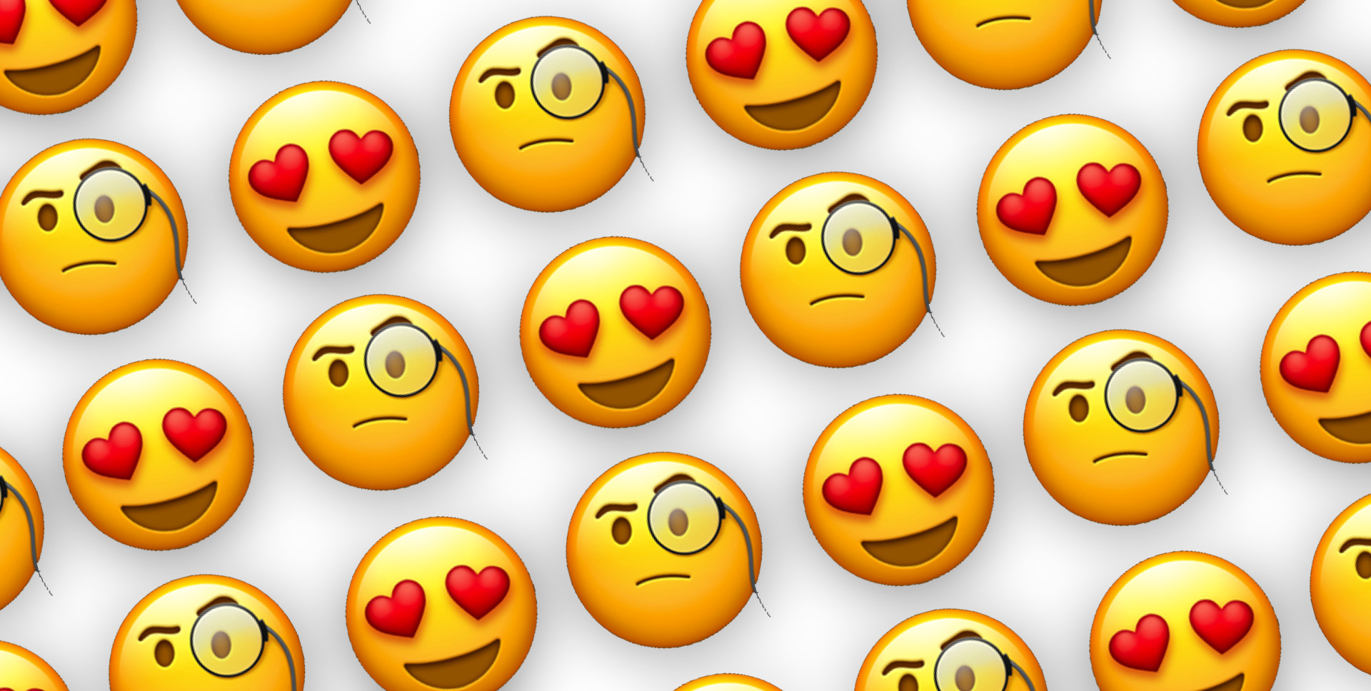 Pattern of Heart Eyes and Monocle Emojis